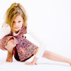 Blond Child Doing A Yoga Pose
