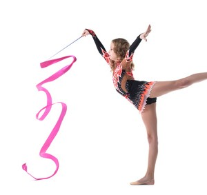 Harmonous Artistic Gymnast Dancing In Studio